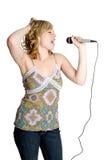 女孩卡拉OK演唱 免版税库存图片