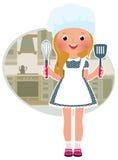 女孩厨师在厨房里 图库摄影