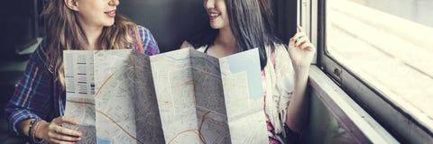 女孩友谊住处旅行的假日地图概念 免版税库存图片