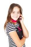 女孩叫由移动电话查出在白色 免版税库存图片