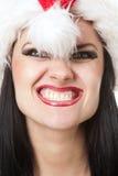 女孩可怕的圣诞老人 免版税图库摄影