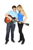 女孩吉他如何显示的人作用 免版税库存图片