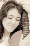 女孩吉他音乐 库存照片