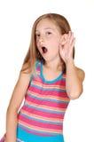 女孩听的年轻人 免版税库存图片