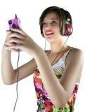 女孩听的音乐少年 免版税库存照片