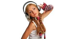 女孩听的音乐 图库摄影