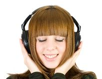 女孩听的音乐 免版税库存照片