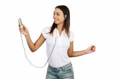 女孩听的音乐 免版税库存图片