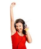 女孩听音乐年轻人 库存图片