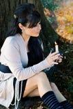女孩吹的蜡烛 免版税库存图片