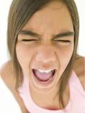 女孩呼喊的年轻人 库存图片