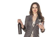 女孩和一个瓶酒 免版税库存照片