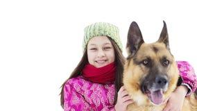 女孩和一只德国牧羊犬 免版税库存图片
