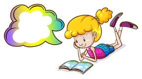 女孩和书 免版税库存图片