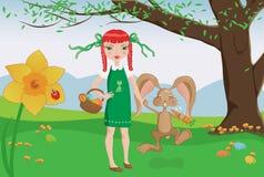 女孩和嬉戏的兔宝宝在复活节彩蛋寻找 免版税库存照片