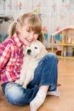 女孩和小狗朋友 库存图片