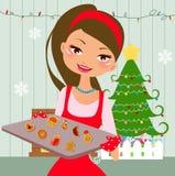 女孩和曲奇饼 免版税图库摄影