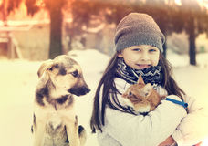 女孩和猫和狗 库存照片