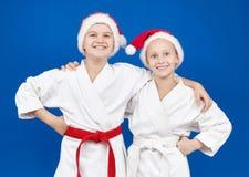 女孩和男孩圣诞老人帽子的 库存图片