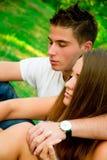 女孩和男孩在公园 库存照片