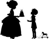 女孩和男孩有holyday蛋糕的 免版税库存图片