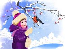 女孩和红腹灰雀 免版税图库摄影