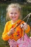 女孩和青蛙 免版税图库摄影