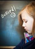 女孩哀伤的学校 免版税库存照片