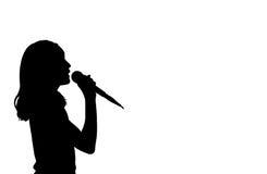 女孩唱歌剪影 库存照片