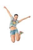 女孩喜悦跳 免版税库存照片