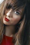 女孩嘴唇纵向猩红色 图库摄影