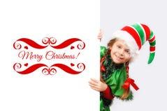 女孩圣诞老人与白色横幅的` s矮子 库存照片