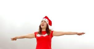 女孩圣诞老人唱歌 库存图片