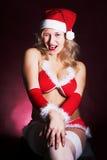 女孩圣诞老人性感的年轻人 图库摄影