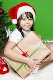 女孩圣诞老人 库存图片