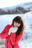 女孩在冬天森林里 免版税库存照片