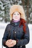 女孩在冬天森林里 图库摄影
