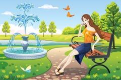 女孩在喷泉的公园 免版税库存照片
