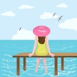 女孩在帽子和海 免版税图库摄影
