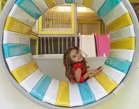 女孩在操场 免版税库存图片