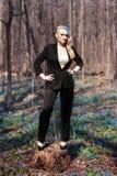 女孩在春天森林 免版税图库摄影