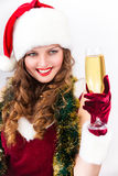 女孩在有香槟玻璃的圣诞老人帽子 免版税库存照片
