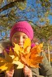 女孩在森林里在秋天 免版税图库摄影