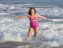 女孩在海洋 库存照片