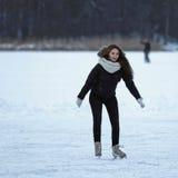 女孩在溜冰场特拉凯立陶宛滑冰 免版税库存照片