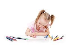 女孩在纸的图画铅笔 库存照片
