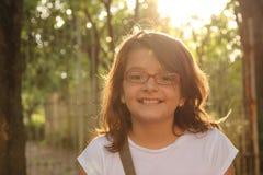 女孩在阳光下 免版税库存照片