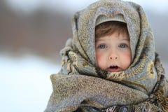女孩在围巾被包裹  免版税库存图片