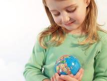 女孩地球藏品 免版税图库摄影