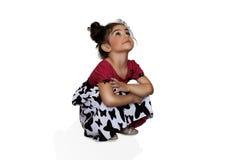 女孩坐她的腰臀部分 免版税库存照片